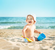 Baby playing at the sea Stock Image