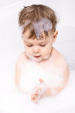 Baby Playing with Shampoo Royalty Free Stock Images