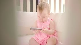 Baby playing with smartphone. Kid girl watching cartoon on mobile. Baby playing with smartphone. Little child watching cartoon on mobile phone. Toddler holding stock video