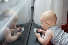 Baby playing with smartphone Stock Photos