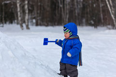 Baby playing in snow royalty free stock images
