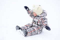 Baby playing with snow in winter Stock Images