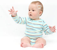 Baby playing with soap bubbles Stock Photography