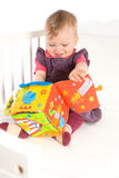 Baby playing with soft toy Royalty Free Stock Photos