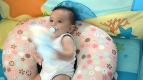 A baby playing with a soft toy stock video
