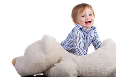 Baby playing with soft toy isolated on white Royalty Free Stock Photos