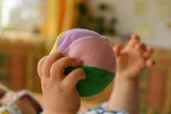 Baby playing with softball - closeup Royalty Free Stock Image
