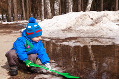 Baby playing in spring mud Royalty Free Stock Photo