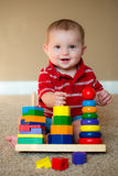 Baby playing with stacking learning toy Stock Photos