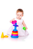 Baby playing with stacking rings Stock Image