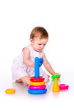 Baby playing with stacking rings Royalty Free Stock Photography