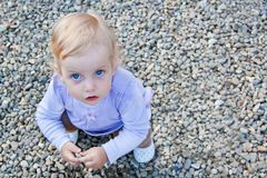 Baby playing with stones Royalty Free Stock Image