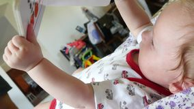 Baby Playing With Story Book stock video footage