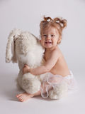Baby playing with stuffed toy animal. Happy baby playing with stuffed toy animal stock photo