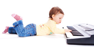 Baby playing synthesizer Royalty Free Stock Image