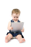 Baby playing with tablet Stock Photography
