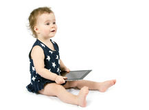 Baby playing with tablet stock images