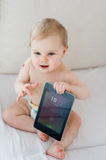 Baby playing with tablet. Cute baby with a tablet at home Royalty Free Stock Photography
