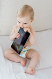 Baby playing with tablet. Cute baby with a tablet at home Royalty Free Stock Photos