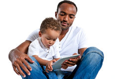 Baby playing with tablet PC under his father's control Royalty Free Stock Image