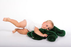 Baby playing with teddy bear royalty free stock image