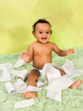 Baby playing with toilet paper Stock Photos