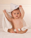 Baby playing with towel Stock Photography