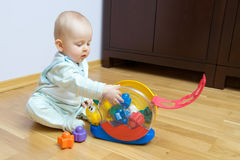 Baby playing with toy royalty free stock photos