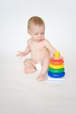 Baby playing with toy Royalty Free Stock Image