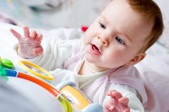 Baby playing with toy Royalty Free Stock Images