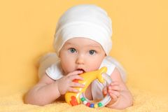 Baby playing with a toy. (girl 6 month Royalty Free Stock Image