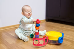 Baby playing with toy. Baby boy playing with blocks building and pointing tower stock images
