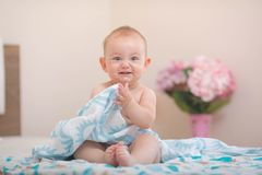 Baby sitting on the bed. stock photography