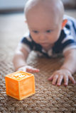 Baby Playing with Toy Block Stock Photo