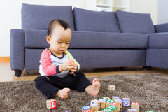 Baby playing toy block Stock Photos