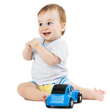 Baby playing with toy cars Stock Photo