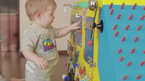 Baby playing with a toy clock. Cute little child 2 stock video