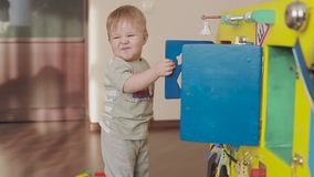 Baby playing with a toy clock. Cute little child 2 stock video footage