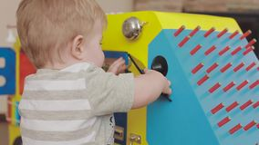 Baby playing with a toy clock. Cute little child 2 years old stock video