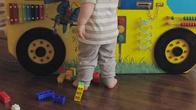 Baby playing with a toy clock. Cute little child 2 years old stock footage