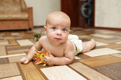 Baby playing with toy on the floor Royalty Free Stock Photos