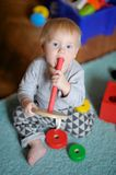 Baby playing with toy Stock Image