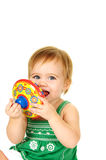 Baby playing with a toy top Stock Image