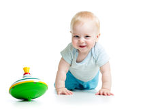 Baby playing with toy whirligig Stock Photo