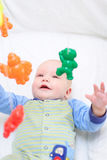 Baby playing with toys #10. Baby playing with toys. Little boy touching the toys by finger Royalty Free Stock Photos