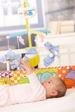 Baby playing with toys Stock Images