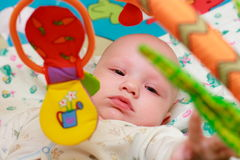 Baby playing with toys. Little boy touching the toy by finger Stock Image