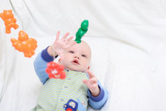 Baby playing with toys #8. Baby playing with toys. Little boy touching the toys by finger Stock Photo