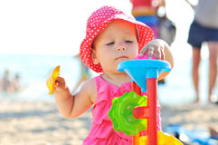 Baby playing toys on the beach Stock Photo