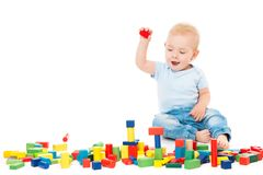 Baby Playing Toys Blocks, Kid Play Building Bricks, One Year Old Child on White. Baby Playing Toys Blocks, Kid Play Building Bricks, One Year Old Child isolated stock photos